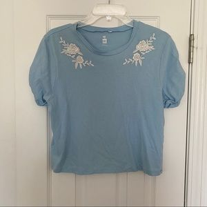 Blue short sleeve top with white flowers